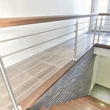 Stainless steel rod railing for interior staircase